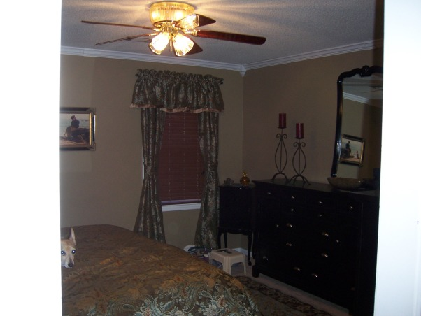 Lighthouse Bedroom, The bedroom is average size and accomodates a California King size bed with the custom iron headboard made by my husband., Purchased staggering candle holders to go with the iron theme in the headboard., Bedrooms Design