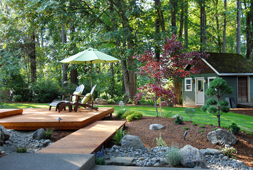 Northwest Outdoor Living...Oregon Style!, This past winter we completed a kitchen addition with doors that opened out into mud :) We've spent the last few weeks redoing our back yard.  The project included large boulders being brought in, new decks and bridges, dry stream bed, sprinkler systems, lighting, a fountain on the patio, concrete patio, new beds and plantings.  All in all we're really happy with the space. We already had a nice canopy of mature trees and in a few years, the new beds should fill in nicely.  We were inspired for this project by our love of the Portland Japanese Gardens. The foliage and simple lines seem to compliment nicely with northwest design. , New cedar decking.      , Outdoor Spaces