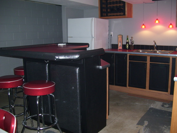 Retro 50s Bar, I built my basement bar-kitchen by myself on a very low budget.  I reused everything I could like 2 by 4s for the walls.  It is a work in progress. I do not want to finish the floor until the adjacent room is at least drywalled and mudded., I still need to paint the refrigerator black.  I made the wine cabinet so that the insert comes out for easy cleaning.  The floor will be maple colored faux wood.      , Basements Design