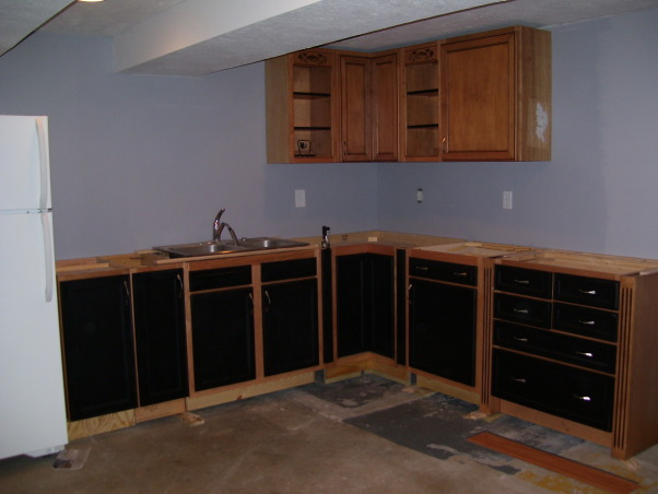 Retro 50s Bar, I built my basement bar-kitchen by myself on a very low budget.  I reused everything I could like 2 by 4s for the walls.  It is a work in progress. I do not want to finish the floor until the adjacent room is at least drywalled and mudded., Do you like the two different colors on the cabinets?      , Basements Design