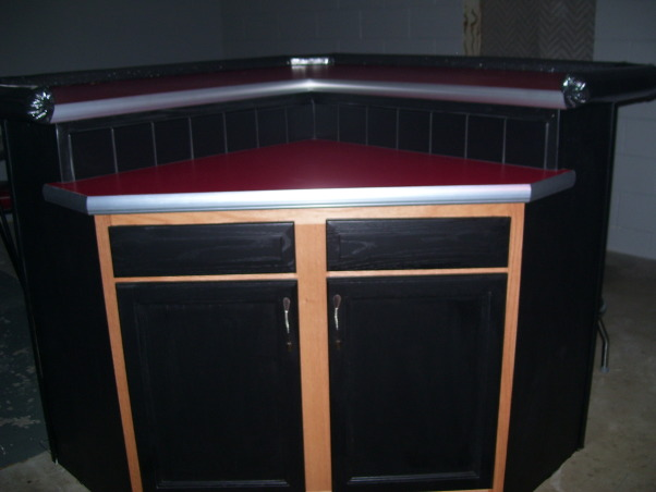 Retro 50s Bar, I built my basement bar-kitchen by myself on a very low budget.  I reused everything I could like 2 by 4s for the walls.  It is a work in progress. I do not want to finish the floor until the adjacent room is at least drywalled and mudded., The bar gives me a nice work area and more cabinet space.     , Basements Design