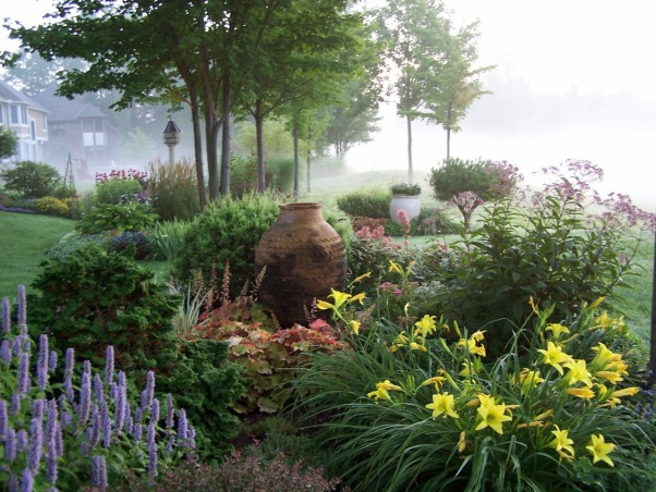 foggy golf course garden, Gardens look so different at different times of day and every once in a while the cat wakes me up early. Often, fog  gathers on the course to form a beautiful backdrop., The pot in the foreground was originally from Turkey and the clay withstands the Cleveland winters without so much as a chip. I just cover the top so snow doesn't accumulate inside it., Gardens Design