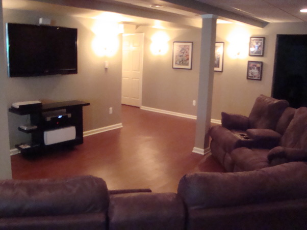 My newly finished basement sports bar, This space was finished in an unfinished lower level walkout basement.  The key was to keep a wide open space, yet make it cozy and warm feeling., The couch and tv are great for sporting events and movies. , Basements Design