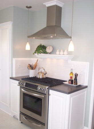 1940's Cottage Kitchen, 1940' Cottage kitchen on a budget., Installed a range hood which the original kitchen lacked and flanked it with pendant lights for much need light & a little modern whimsy.     , Kitchens Design