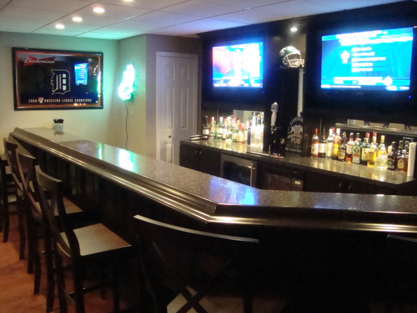 My newly finished basement sports bar, This space was finished in an unfinished lower level walkout basement.  The key was to keep a wide open space, yet make it cozy and warm feeling., Basements Design