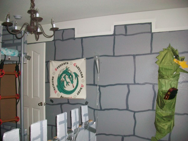 Dragon & Castle Room, Boys bedroom in the theme of a castle or dungeon complete with dragon!, Found the poster at a thrift store for 75 cents. The hanging dragons are from ikea, for toys. I painted all of the walls like that. The light gray does not make the room feel dark at all.  , Boys' Rooms Design