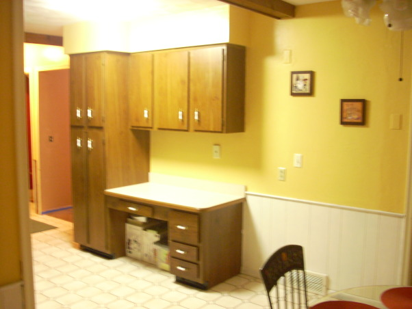 Italian Bistro Kitchen, I am trying to have an Italian inspired kitchen, since I come from an Italian/Mexican background. My husband and I don't agree on certain decorative ideas for our kitchen, but we are working on it. I need some ideas on how to make this space feel more cozy and perhaps more modern. This kitchen is still stuck in the 70's. Any tips?, This is useless space. Very outdated, and not enough storage/cabinet space., Kitchens Design