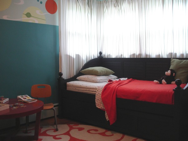 A Physicist in the Making, This 4 year old's room is the smallest in the house so his furniture is extra efficient. He has a trundle bed for company and bookshelves piled high with toys. Lots of colors and an imaginary universe mural on the wall., Boys' Rooms Design