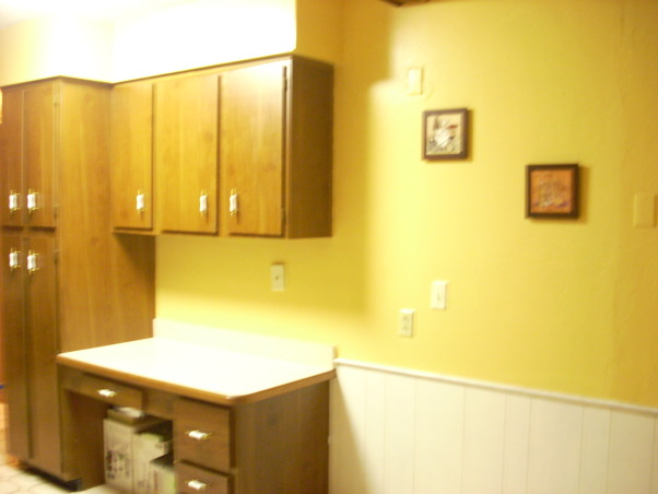 Italian Bistro Kitchen, I am trying to have an Italian inspired kitchen, since I come from an Italian/Mexican background. My husband and I don't agree on certain decorative ideas for our kitchen, but we are working on it. I need some ideas on how to make this space feel more cozy and perhaps more modern. This kitchen is still stuck in the 70's. Any tips?, Kitchens Design