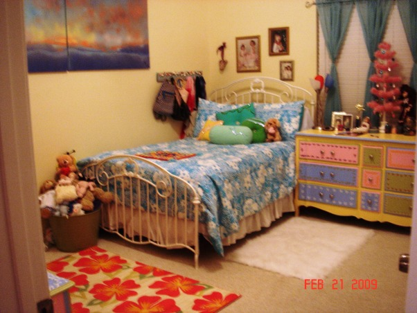 "Girl's Beach Bedroom, Beach inspired bedroom of 13-year-old girl, This bedroom needs help!  My daughter wanted a ""beach bedroom"" and we've put it together using what we had.  She picked out the hibiscus rug because she wants to add some bright pink to the room.  Now she wants to repaint her furniture to match the shade of the flowers..., Girls' Rooms Design"