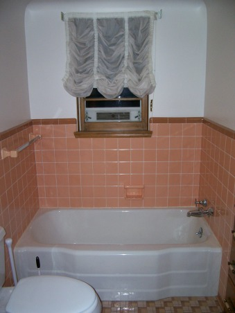 Pleasantly Peach??, Good bathroom setup, but very outdated!  The vanity and built-in storage are great.  The peach tile, outdated wallpaper, and no shower are not so great.  Does anyone know a good method for taking off wallpaper?  Help!, Bathtub.  Never use - how do we install a shower with a window in there?    , Bathrooms Design