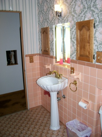Pleasantly Peach??, Good bathroom setup, but very outdated!  The vanity and built-in storage are great.  The peach tile, outdated wallpaper, and no shower are not so great.  Does anyone know a good method for taking off wallpaper?  Help!, Sink and built-in storage.  What era is this sink from?    , Bathrooms Design