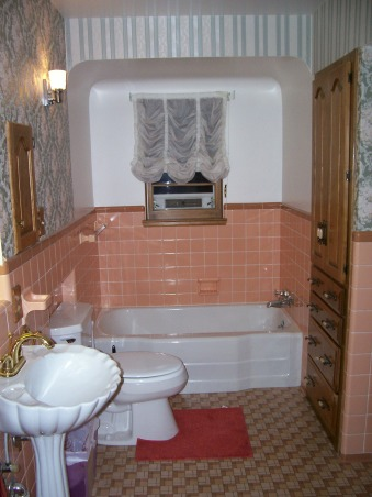 Pleasantly Peach??, Good bathroom setup, but very outdated!  The vanity and built-in storage are great.  The peach tile, outdated wallpaper, and no shower are not so great.  Does anyone know a good method for taking off wallpaper?  Help!, Overall view.  Outdated wallpaper, tile, floor, and sink.  Does anyone know a good method for taking off wallpaper?    , Bathrooms Design
