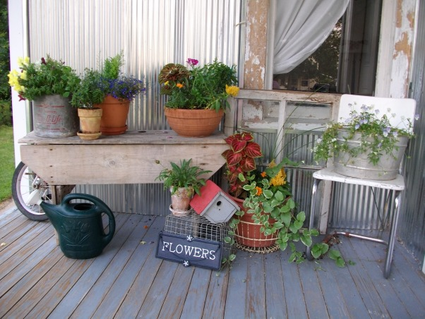 Super Sweet Space, My front porch is lined with galvenized steel and beautifully accented with containers of flowers. Weather worn wood makes it look all the more welcoming., Up close and personal., Porches Design