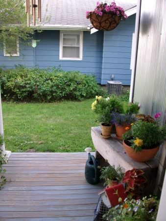 Super Sweet Space, My front porch is lined with galvenized steel and beautifully accented with containers of flowers. Weather worn wood makes it look all the more welcoming., First view in the morning., Porches Design