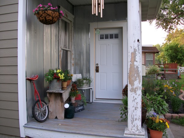 Super Sweet Space, My front porch is lined with galvenized steel and beautifully accented with containers of flowers. Weather worn wood makes it look all the more welcoming., Shabby, shabby chic., Porches Design
