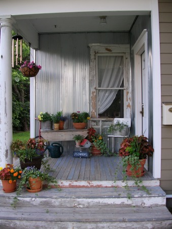Super Sweet Space, My front porch is lined with galvenized steel and beautifully accented with containers of flowers. Weather worn wood makes it look all the more welcoming., Welcome home!, Porches Design