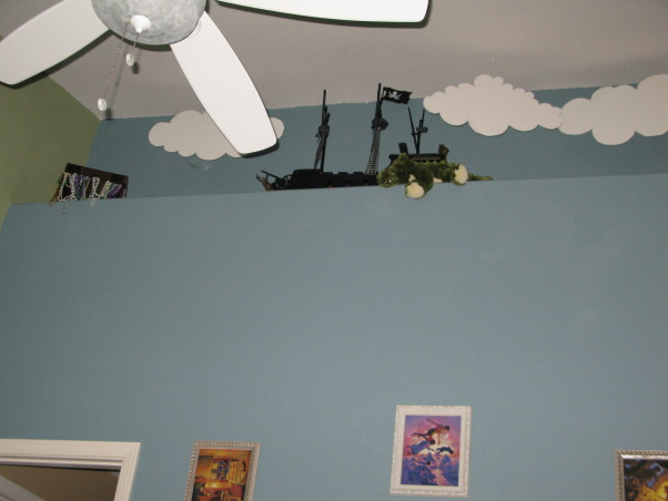 Vintage Peter Pan , I have always loved the movie hook and wanted to do a room inspire by the nursery in that. So here is the Nursery for our Baby Jenevieve. , We found this pirate ship at Toys R us of $10 (open box) If you have peter you have to have the pirates. The clouds we cut out. We also have Tic Toc up there and and treasure chest. , Nurseries Design