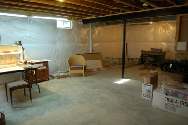 Art Studio, I use my unfinished basement as a studio for drawing and relief printmaking, a passion to which I have recently returned.  The space is large, with high ceilings, but poor lighting.  I have added some lighting, some work tables, and a shelving unit for storage.  I want to add more lighting, flat files for storing my papers (some of which are large), walls to partition the space and display pieces as I finish them, drying racks for my prints, and more surface work space to accommodate messy projects.  I would also like to add some cabinets for storage and a large sink for cleaning up so that I don't have to run upstairs every time I need to wash my hands (which is often when I'm working with pastels). There is a rough-in for a bathroom, which is in the middle of one side of the basement and would help with installing a work sink, but there are no walls partitioning the space.  The good news is that it's a blank slate for doing whatever I want; the bad news is that I really don't know where to begin.  Any advice would be welcome., This is a view looking back in the opposite direction.  It's just a dumping ground for empty boxes.      , Basements Design