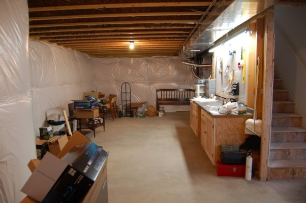 Art Studio, I use my unfinished basement as a studio for drawing and relief printmaking, a passion to which I have recently returned.  The space is large, with high ceilings, but poor lighting.  I have added some lighting, some work tables, and a shelving unit for storage.  I want to add more lighting, flat files for storing my papers (some of which are large), walls to partition the space and display pieces as I finish them, drying racks for my prints, and more surface work space to accommodate messy projects.  I would also like to add some cabinets for storage and a large sink for cleaning up so that I don't have to run upstairs every time I need to wash my hands (which is often when I'm working with pastels). There is a rough-in for a bathroom, which is in the middle of one side of the basement and would help with installing a work sink, but there are no walls partitioning the space.  The good news is that it's a blank slate for doing whatever I want; the bad news is that I really don't know where to begin.  Any advice would be welcome., This is a view of the opposite side of the basement where I have a work bench that houses all my tools.  A girl's gotta have tools., Basements Design