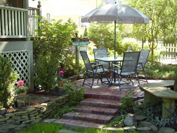 Backyard Escape, Our new backyard patio overlooks a small garden with pond and fountain., The steps are a perfect flow into both the yard and the patio.       , Gardens Design
