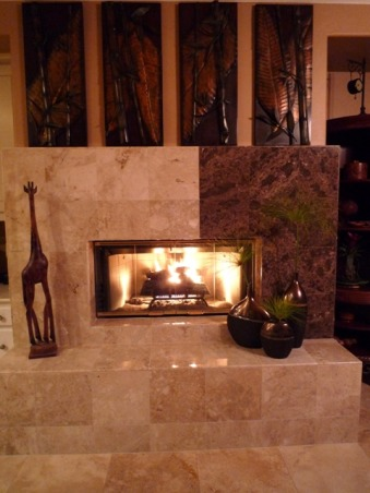 Out of the Ordinary..., We recently had a flood in our home and the drywall was damaged about 1 ft. up, so I decided to take the opportunity to create a new more contemporary fireplace. It's unique and more substantial than the previous flat wall fireplace. We chose two types of marble. It really is the focal point now in our family room., AFTER  , Living Spaces