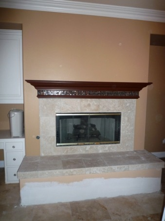 Out of the Ordinary..., We recently had a flood in our home and the drywall was damaged about 1 ft. up, so I decided to take the opportunity to create a new more contemporary fireplace. It's unique and more substantial than the previous flat wall fireplace. We chose two types of marble. It really is the focal point now in our family room., BEFORE  , Living Spaces