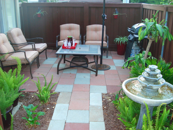 Small Patio Makeover, When I purchased my condo, my patio was left like a junk yard, even when the stuff was removed it was terrible. The patio was made of some kind of cement with large rock mixed in, the large blocks were separated with rotted 2x4's. I didn't have much of a budget, so I hit the pennysaver for used garden stones, and Big Lots for the patio furniture. This is what my $400 plus a lot of sweat, make over turned out like. I would love to hear your thoughts., This very small patio makeover was accomplished on a very small budget., Patios & Decks Design