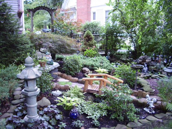 Backyard Escape, Our new backyard patio overlooks a small garden with pond and fountain., Gardens Design