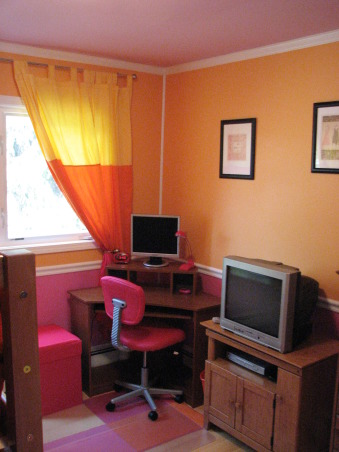 Pink & Orange Room, We wanted to give her a space that was fun & bright. Pink is her favorite color but I couldn't see an entirely pink room. We also wanted her to have a space where she could do her homework & hang out with her friends. Needless to say when she returned home after a summer @ her mom's she was tickled pink. We used real bamboo wood flooring figuring it would be able to withstand the abuse a 10 year could put it through besides the fact it is a renewable resource., New desk & desk chair with side pink storage compartment that doubles as seating. Found the chair @ OfficeMax for under $25.00, Girls' Rooms Design