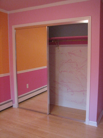 Pink & Orange Room, We wanted to give her a space that was fun & bright. Pink is her favorite color but I couldn't see an entirely pink room. We also wanted her to have a space where she could do her homework & hang out with her friends. Needless to say when she returned home after a summer @ her mom's she was tickled pink. We used real bamboo wood flooring figuring it would be able to withstand the abuse a 10 year could put it through besides the fact it is a renewable resource., Decided to do some splatter paint for fun in the closet. We tried it on the orange wall but it was far too busy in an already busy room., Girls' Rooms Design