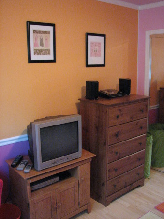 Pink & Orange Room, We wanted to give her a space that was fun & bright. Pink is her favorite color but I couldn't see an entirely pink room. We also wanted her to have a space where she could do her homework & hang out with her friends. Needless to say when she returned home after a summer @ her mom's she was tickled pink. We used real bamboo wood flooring figuring it would be able to withstand the abuse a 10 year could put it through besides the fact it is a renewable resource., Dresser from Wal-Mart $75.00 - room is rather small so needed an upright for more space. House was built in 1970 when bedrooms & bathrooms were tiny., Girls' Rooms Design