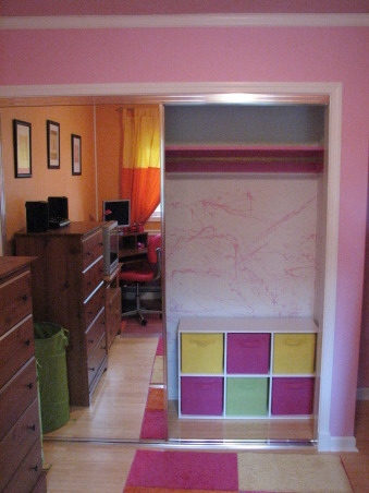 Pink & Orange Room, We wanted to give her a space that was fun & bright. Pink is her favorite color but I couldn't see an entirely pink room. We also wanted her to have a space where she could do her homework & hang out with her friends. Needless to say when she returned home after a summer @ her mom's she was tickled pink. We used real bamboo wood flooring figuring it would be able to withstand the abuse a 10 year could put it through besides the fact it is a renewable resource., Storage cabinet & canvas drawers from Lowe's, Girls' Rooms Design