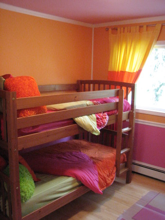 Pink & Orange Room, We wanted to give her a space that was fun & bright. Pink is her favorite color but I couldn't see an entirely pink room. We also wanted her to have a space where she could do her homework & hang out with her friends. Needless to say when she returned home after a summer @ her mom's she was tickled pink. We used real bamboo wood flooring figuring it would be able to withstand the abuse a 10 year could put it through besides the fact it is a renewable resource., All new bedding in pink, orange & lime green all at Wal-Mart, Girls' Rooms Design