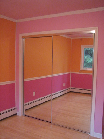 Pink & Orange Room, We wanted to give her a space that was fun & bright. Pink is her favorite color but I couldn't see an entirely pink room. We also wanted her to have a space where she could do her homework & hang out with her friends. Needless to say when she returned home after a summer @ her mom's she was tickled pink. We used real bamboo wood flooring figuring it would be able to withstand the abuse a 10 year could put it through besides the fact it is a renewable resource., New mirrored closet doors replaced dark stained wood doors, Girls' Rooms Design