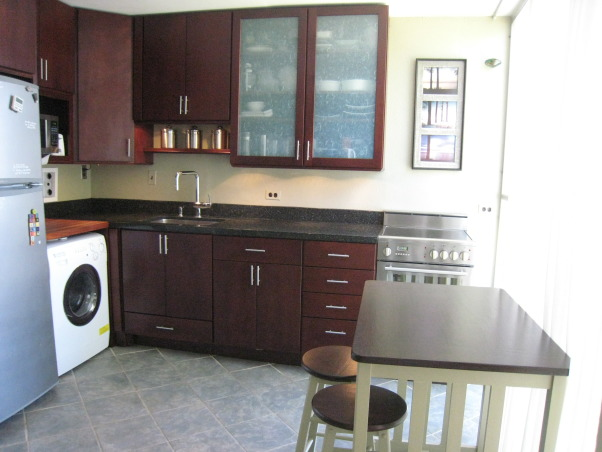 Small kitchen remodel, Small kitchen in condo. New cabinets, sink stove, refrigerator, and used combo washer/dryer. , We had a maple top table with white legs, so we stained it to match the cabinets and painted the legs to match the wall.     , Kitchens Design