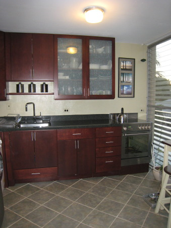 Small kitchen remodel, Small kitchen in condo. New cabinets, sink stove, refrigerator, and used combo washer/dryer. , Kitchens Design