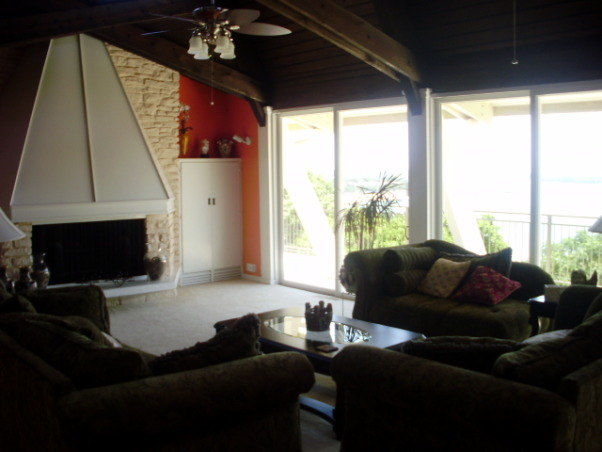 Our funky fireplace!, Large living room with gorgeous lake views.  Wall of sliding glass doors, and lofty cedar beemed ceiling.  Built in 1965!  Check out the fireplace!, We now have white leather furniture.  The color of the wall is all wrong., Living Rooms Design
