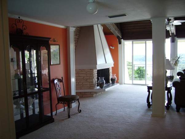 Our funky fireplace!, Large living room with gorgeous lake views.  Wall of sliding glass doors, and lofty cedar beemed ceiling.  Built in 1965!  Check out the fireplace!, Living Rooms Design
