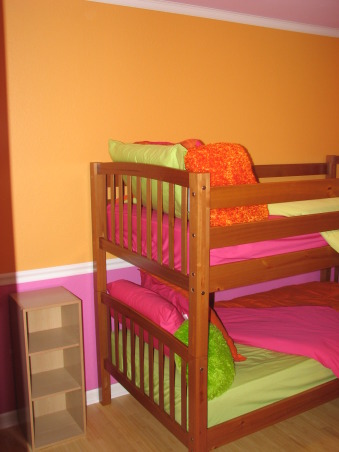 Pink & Orange Room, We wanted to give her a space that was fun & bright. Pink is her favorite color but I couldn't see an entirely pink room. We also wanted her to have a space where she could do her homework & hang out with her friends. Needless to say when she returned home after a summer @ her mom's she was tickled pink. We used real bamboo wood flooring figuring it would be able to withstand the abuse a 10 year could put it through besides the fact it is a renewable resource., This picture is more accurate on the actual colors than the other pictures. Very bright but considering we live in Alaska it will work great during our 6 months of darkness., Girls' Rooms Design
