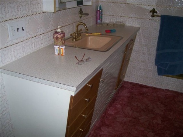 My 1955 Bathroom-Pretty in Pink, Our home was built in 1955, and we purchased in June 2009.  I believe the bathroom has had no renovation since it was built.  As you can see the pretty pink carpet, the glass mirrors on the walls and the lovely renaissance fixtures, please help me fix this space., The vanity has doors made from pegboard., Bathrooms Design