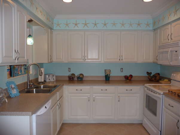 Beach Style Kitchen Makeover, Renovated old dull kitchen with bright beach style., The ALMOST finished kitchen. (I forgot that I need two switchplate covers!)  , Kitchens Design