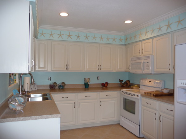 Beach Style Kitchen Makeover, Renovated old dull kitchen with bright beach style., New floor to new ceiling view!  , Kitchens Design
