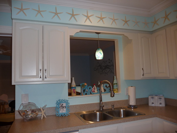 Beach Style Kitchen Makeover, Renovated old dull kitchen with bright beach style., New sink and faucet.  (And real starfish.)  , Kitchens Design