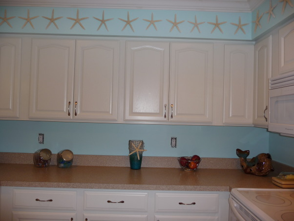 Beach Style Kitchen Makeover, Renovated old dull kitchen with bright beach style., Newly painted cabinets and new countertops.  , Kitchens Design