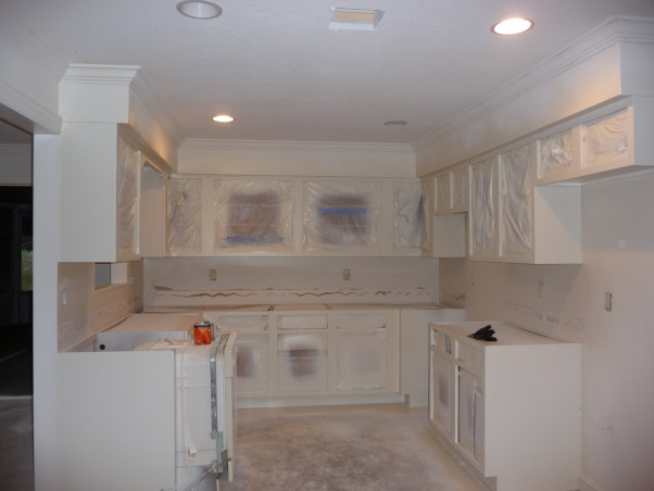 Beach Style Kitchen Makeover, Renovated old dull kitchen with bright beach style., Primed cabinets and new lighting., Kitchens Design