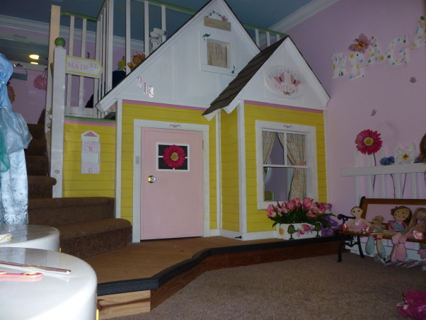 Little Girls' Cottage , my husband built this playhouse bed for our 2 1/2 yr old twin girls.  It is a Queen size bed up top for them to share and a playhouse on the bottom.  They love it.  I have had a great time making their house a home.  I added an address and a street sign as well as a street light to make it more real for them.  It is not quite done though.  I have some painting to finish and I haven't found the right fabric for the bedroom window yet.   Any suggestions? , My girls requested a door and doorbell, now at three they are really getting a lot of use out of their playhouse., Girls' Rooms Design