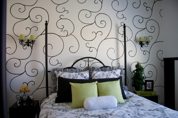 Black, White and Green , I got the inspiration for the scroll design behind the bed from a wall paper I saw in a model home. I had to create a stencil on a piece of cardboard. I then hand painted the scroll design on the wall.   For those of you that have inquired about the bedding, it was purchased at JC Penny. , Bedrooms Design