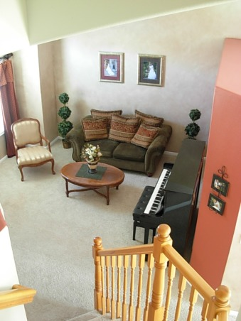 Red, Gold, and Faux, A small room with high arched ceilings. There is brown faux finish on the walls, but it may be hard to tell. Hoping for a classy, timeless effect while on a penny budget, and a room to inspire me while writing music on the piano., view from upstairs hallway  , Living Rooms Design