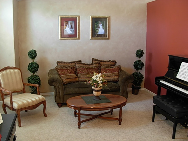 Red, Gold, and Faux, A small room with high arched ceilings. There is brown faux finish on the walls, but it may be hard to tell. Hoping for a classy, timeless effect while on a penny budget, and a room to inspire me while writing music on the piano., Simple, yet elegant small front room. The brown faux finish provides a luxurious old world feel in the room.   , Living Rooms Design